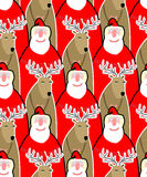 Santa Claus and reindeer seamless background. Vector ornament fr Stock Photos