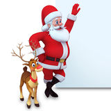 Santa claus and reindeer with sign Stock Photo