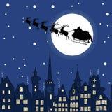 Santa Claus with reindeer sleigh through a Christmas night Royalty Free Stock Photos