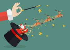 Santa claus with reindeer sleigh flying out of the magic hat Royalty Free Stock Photo