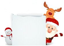 Santa Claus with reindeer and snowman with blank sign Stock Photos