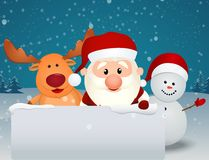 Santa Claus with reindeer and snowman with blank sign Royalty Free Stock Images