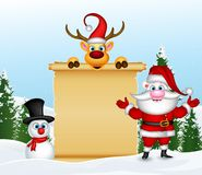 Santa claus with reindeer and snowman with blank sign in winter landscape Stock Photos