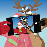 Santa Claus and reindeer take a selfie. Royalty Free Stock Images