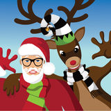 Santa Claus and reindeer wave hello. Stock Images