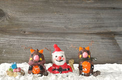 Santa claus with reindeers Stock Photo