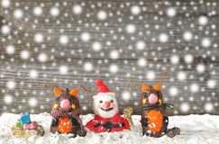 Santa claus with reindeers Stock Images