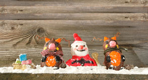 Santa claus with reindeers Royalty Free Stock Image
