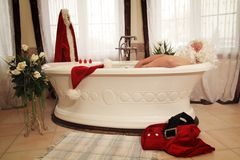 Santa claus relax. Santa claus having a rest in a bath after his  gifts run Stock Photo