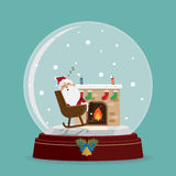 Santa claus relax fireplace in snow globe Royalty Free Stock Photography