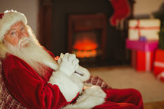Santa claus relaxing on the couch Royalty Free Stock Photos