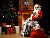 Santa Claus relaxing and having latte Royalty Free Stock Photos