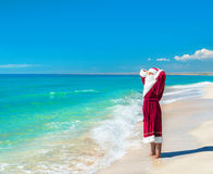 Santa Claus relaxing at sea beach - Christmas concept Royalty Free Stock Photography
