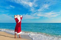 Santa Claus relaxing at sea beach Royalty Free Stock Photo