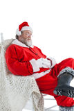 Santa claus relaxing on sofa Royalty Free Stock Images