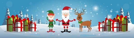 Santa Claus, reno y duende sonrientes de la Navidad con Feliz Año Nuevo de las cajas del presente del día de fiesta Imagen de archivo