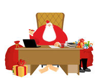 Santa Claus residence. Christmas big boss in Work office. Jobs a. Nd armchair chief. Elf helper in green suit. Large red sack of gifts for children. New Year Royalty Free Stock Images