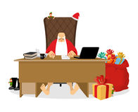 Santa Claus residence. Christmas big boss in Work office. Jobs a. Nd armchair chief. Elf helper in green suit. Large red sack of gifts for children. New Year Royalty Free Stock Photos