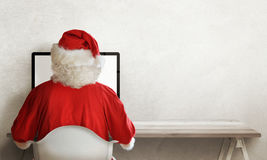 Santa Claus responds to letter of wishes on a computer Stock Photo