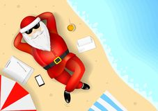 Santa Claus resting on the beach. Santa Claus resting and lying on a tropical beach. The list of gifts. The ocean and the sand with the waves Royalty Free Stock Photo