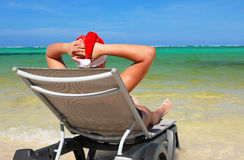 Santa Claus resting on chaise longue. On caribbean sea stock photography