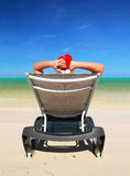 Santa Claus resting on chaise-longue. On caribbean sea stock photography