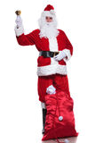 Santa claus is resting and ringing his bell Stock Photography
