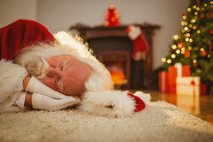 Santa claus resting on the rug Royalty Free Stock Photos