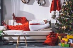 Santa claus resting on sofa Stock Image
