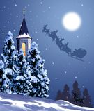 Santa Claus Rides. Santa Claus on Christmas Eve riding his sleigh over a church stock illustration