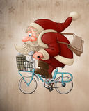 Santa Claus rides the bicycle. Santa Claus rides a bicycle to delivery the gifts Royalty Free Stock Photography