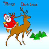 Santa claus rides on deer Stock Photo