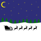 Santa claus rides on deer Royalty Free Stock Images