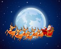 Santa Claus rides reindeer sleigh against a full moon background Stock Images
