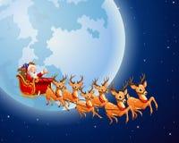 Santa Claus rides reindeer sleigh against a full moon background Stock Photos
