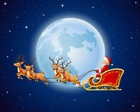 Santa Claus rides reindeer sleigh against a full moon background Royalty Free Stock Photos