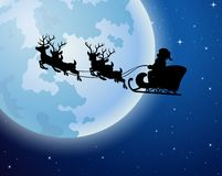 Santa Claus rides reindeer sleigh silhouette against a full moon background Stock Images
