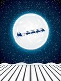Santa Claus rides in a reindeer sleigh Royalty Free Stock Photography