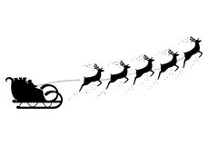 Santa Claus rides in a sleigh in harness. On the reindeer Stock Photos