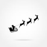 Santa Claus rides in a sleigh in harness Royalty Free Stock Photo