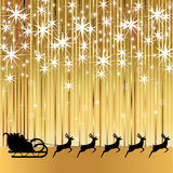 Santa Claus rides in a sleigh with reindeer. On a gold background Stock Images