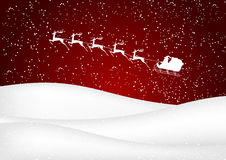Santa Claus rides in a sleigh reindeer on red background Royalty Free Stock Photo