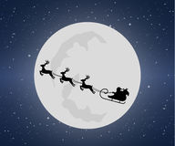 Santa Claus rides in a sleigh with their reindeer. Through the night mountains Stock Images