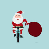 Santa Claus riding bicycle . Stock Images