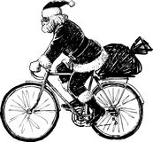 Santa Claus riding a bicycle Royalty Free Stock Photos