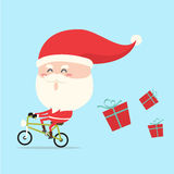 Santa claus riding bike. Santa claus riding bicycle in christmas Royalty Free Stock Photography