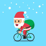 Santa claus riding bike Stock Photography