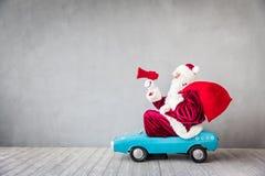 Santa Claus. Riding car. Senior man speaking into megaphone. Christmas Xmas holiday concept Stock Images