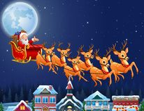 Santa Claus riding his reindeer sleigh flying over town Royalty Free Stock Images