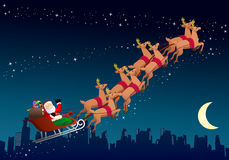 Santa claus riding his sleigh Royalty Free Stock Photography